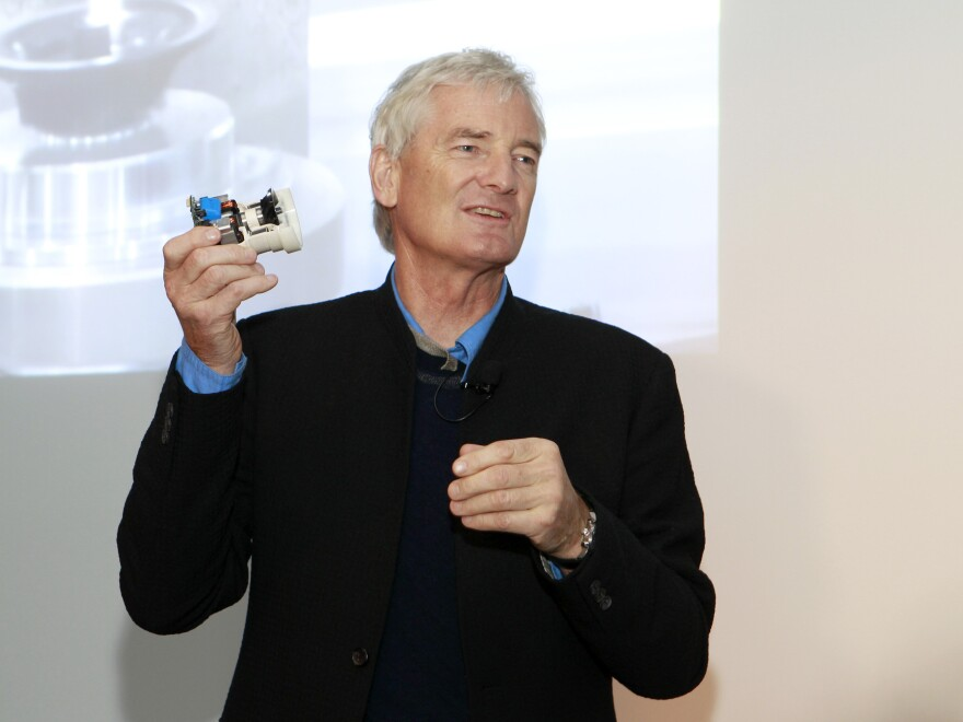 Founder James Dyson speaks at a launch event in 2013 for the Dyson Airblade, a high-power hand dryer found in public bathrooms. The Dyson company may be branching out into electric cars.