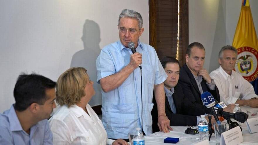 RED SCARE RETROSPECTIVE Former Colombian President Alvaro Uribe shares his 'Castro-Chavismo' warnings with Republican Miami congressional leaders during his visit to Doral in 2016.