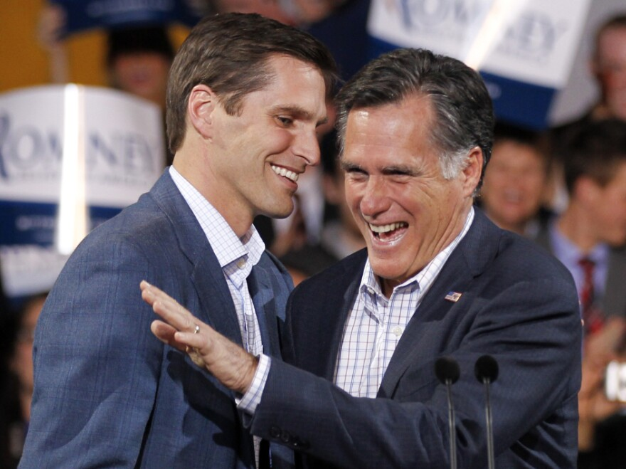 Republican presidential candidate Mitt Romney, seen at an election night rally in Denver with his son Josh on Feb. 7, once rode to the rescue on a Jet Ski.