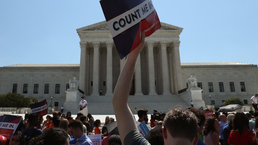 People gather in front of the Supreme Court last week, some opposing the controversial citizenship question that the Trump administration tried to add to the 2020 census.