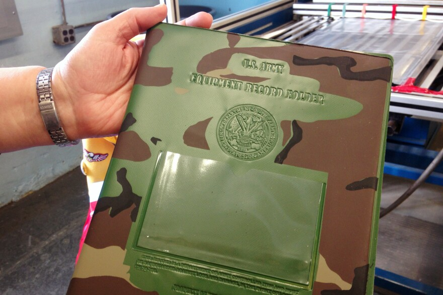 In sheltered workshops, people with disabilities are paid according to how quickly they're able to complete tasks. Usually, they make well below minimum wage. At Production Unlimited, they make office supplies, safety equipment and binders for the U.S. Army.
