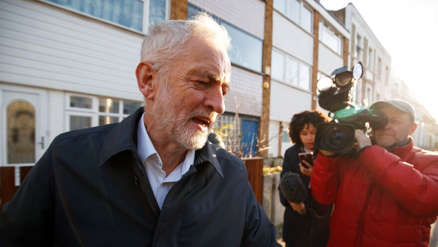 Labour Party leader Jeremy Corbyn leaves his home in London on Monday, surrounded by journalists.