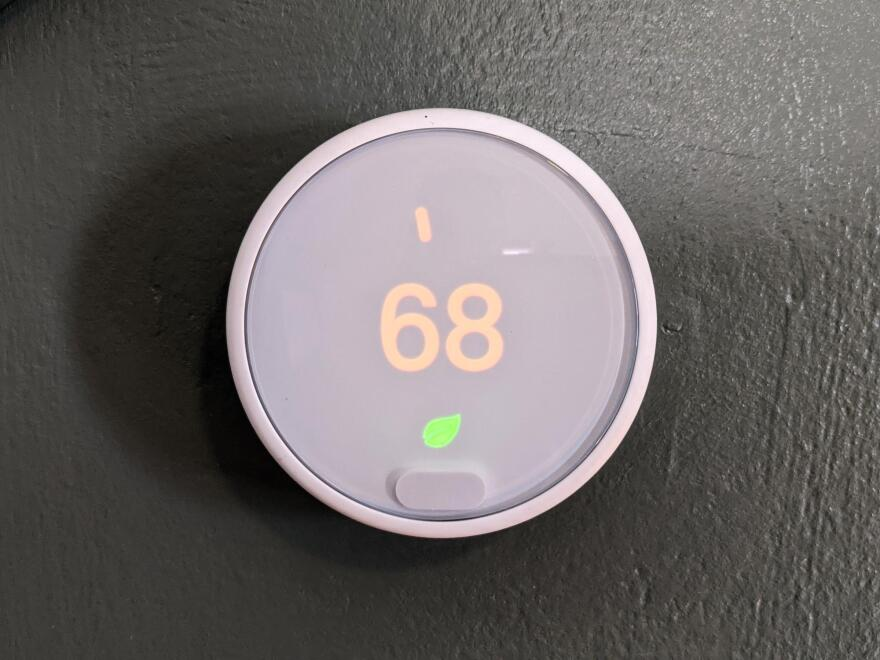 A thermostat showing 68 degrees.