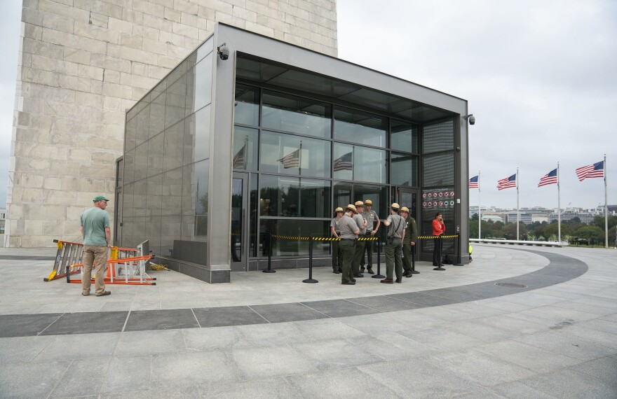 National Park Service rangers stand outside the newly constructed screening facility.