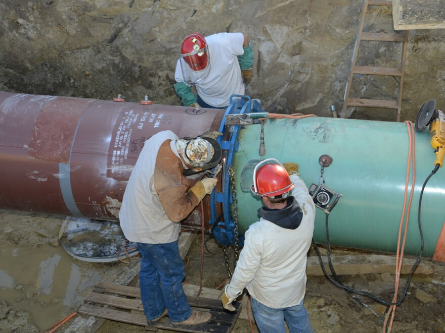Pipefitters work on construction of the Keystone XL pipeline's southern portion outside Tulsa, Okla., in January.