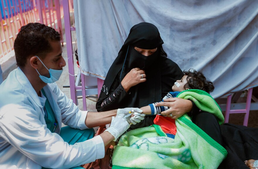 A Yemeni child suspected of being infected with cholera is treated at a hospital in Sanaa in May.