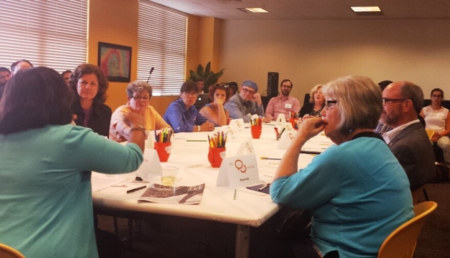 Felicia Shaw sits at the head of the table in one of five meetings with organizations that receive RAC funding.
