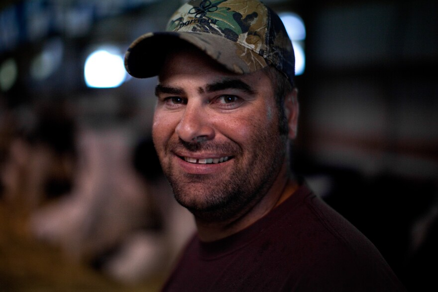 """Charlie Knigge is a dairy farmer from Omro, Wis. He talked to NPR at the Winnebago County Fair in Oshkosh. """"I'm not a big fan of how big the government's gotten or how many people are living off the government now,"""" he says."""