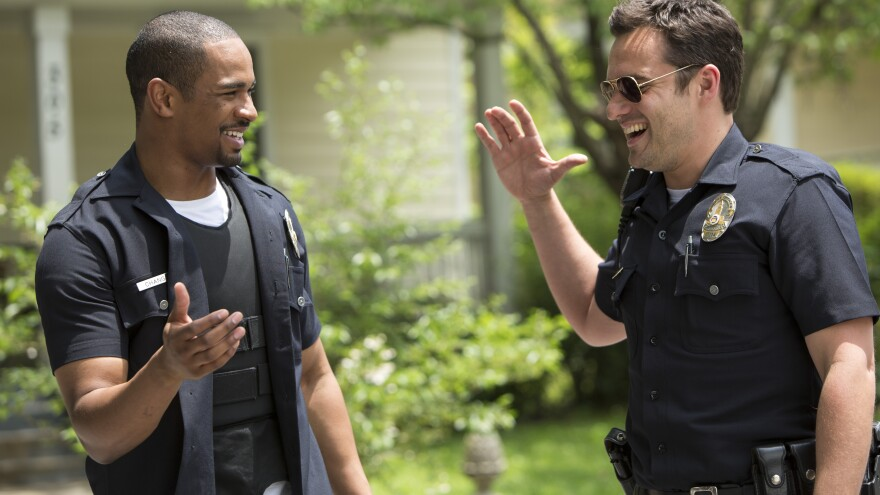 Duuuuuuude! Damon Wayans Jr. and Jake Johnson explore the whimsical fun of petty tyranny in <em>Let's Be Cops</em>.