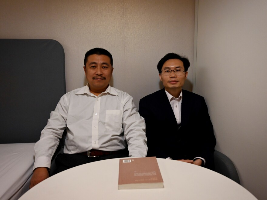Lawyers Ren Quanniu (left) and Zhang Keke representing Chinese citizen journalist Zhang Zhan, who reported on Wuhan's coronavirus outbreak and was detained in May, during an interview with Agence France-Presse on Dec. 27 in Shanghai ahead of their client's trial.