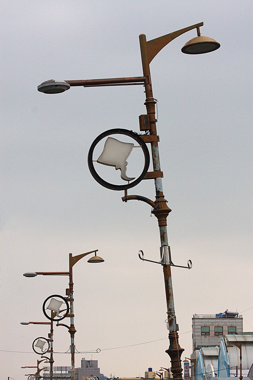 Trawling for skate, the key ingredient in <em>hongeo</em>, is big business in Mokpo's bustling harbor, as the decorations on these lampposts attest.
