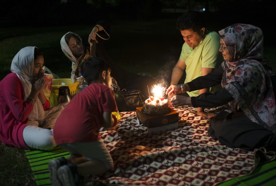 A family gathers in a Tehran park the night before a public holiday in August.