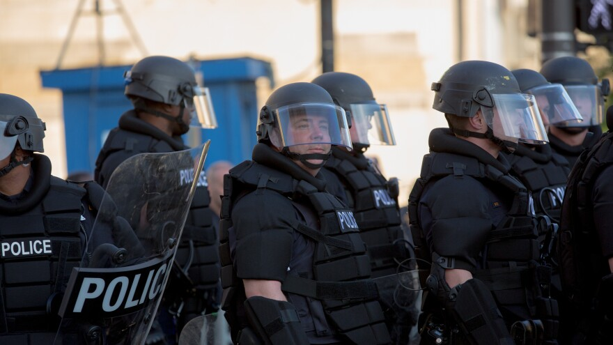Police stand guard during demonstrations in reaction to a Cleveland police officer being acquitted of manslaughter charges on May 23, 2015, in Cleveland.