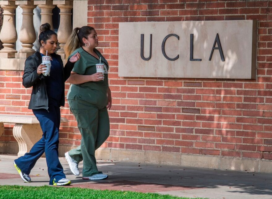 People walk through the campus of the UCLA college in Westwood, California. The UC system has announced that they will phase out the use of the SAT and ACT in their admissions process.