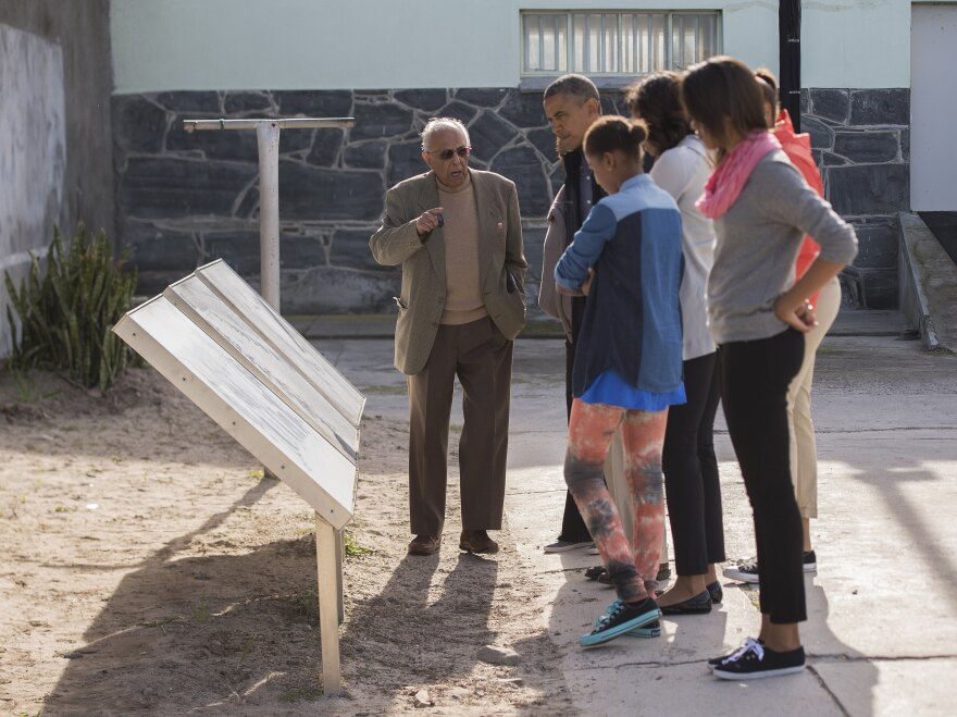 Kathrada (left), showed the Obama family around Robben Island on June 30, 2013. Kathrada chose to live on the island in his later years.