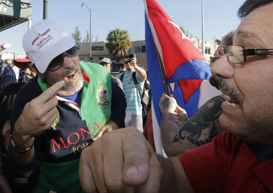 Anti-Castro protester Lazaro Lozano (left) argues with an unidentified pro-Obama supporter in the Little Havana area of Miami on Wednesday.