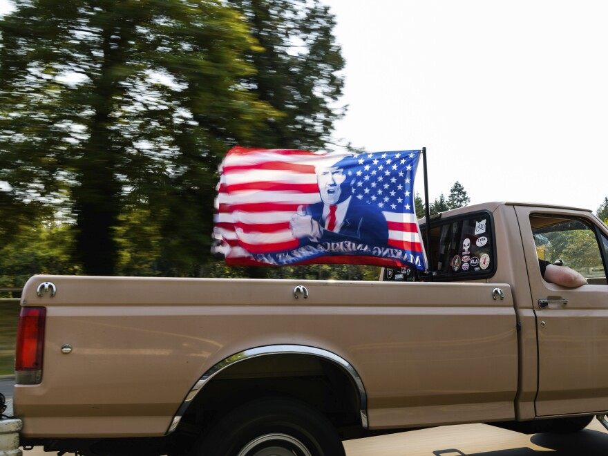 "A caravan of vehicles make their way along the Interstate 205 South freeway during the ""Oregon for Trump 2020 Labor Day Cruise Rally,"" at Clackamas Community College in Oregon City, Ore., on Sept. 7, 2020."