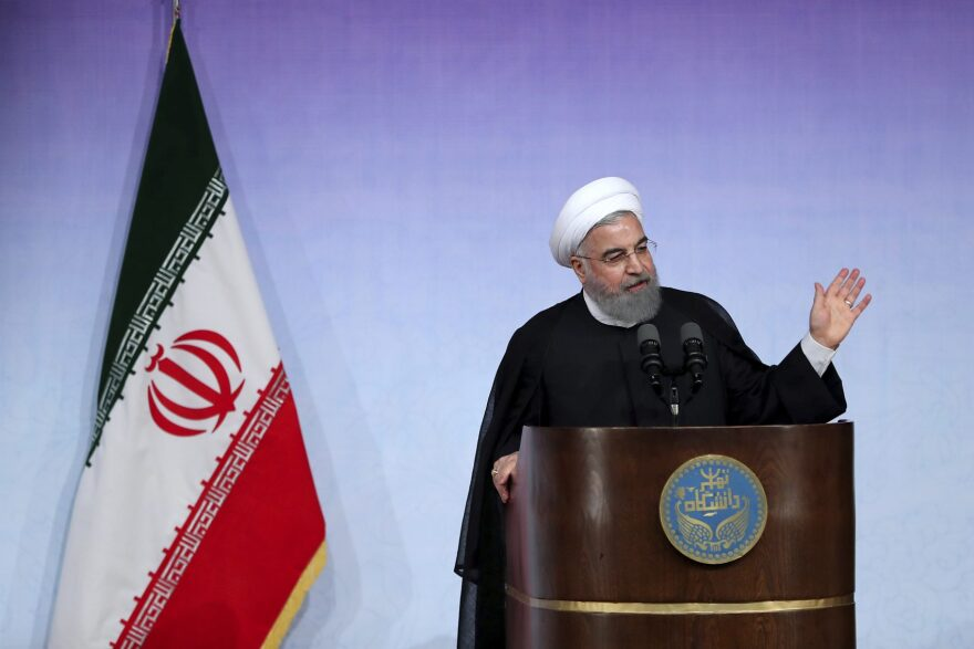 In this photo released by the official website of the office of the Iranian Presidency, Iran's President Hassan Rouhani speaks during a ceremony marking the beginning of new Iranian academic year at the Tehran University, in Tehran, Iran, Saturday, Oct. 7, 2017. Iran's president on Saturday defended the 2015 nuclear deal with world powers, saying not even 10 Donald Trumps can roll back its benefits to his country as President Trump appears to be stepping back from his campaign pledge to rip up the deal, instead aiming to take other measures against Iran. (Iranian Presidency Office via AP)