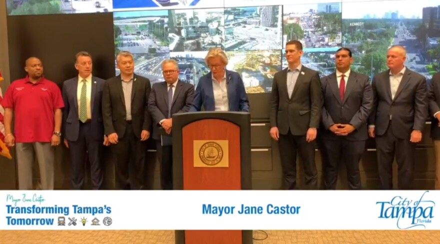 Tampa Mayor Jane Castor stands at a podium with transportation officials.