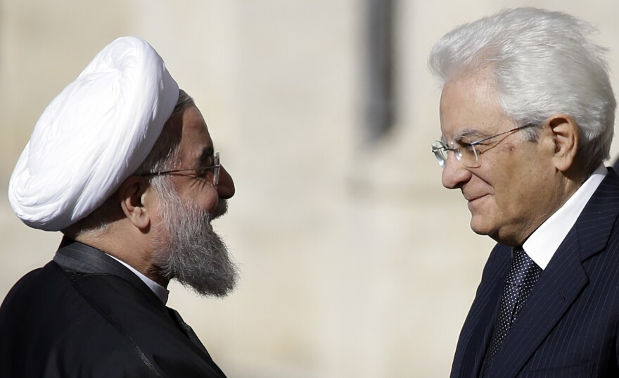 Iranian President Hassan Rouhani (left) meets Italian President Sergio Mattarella at the presidential palace in Rome on Monday. With many international sanctions against Iran lifted, Rouhani has become the first Iranian president to tour Europe since 1999.