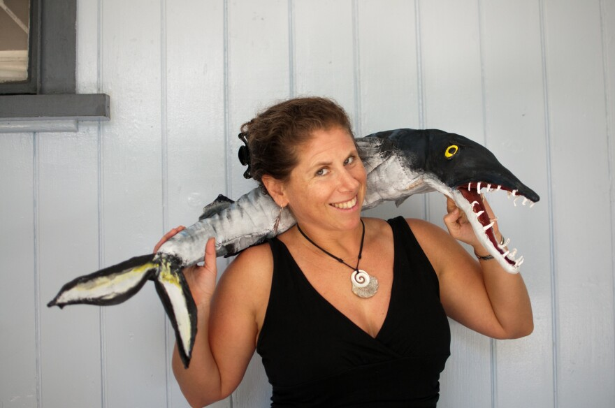 Stacy Jupiter, a newly named MacArthur Fellow, poses with a puppet used in a show she staged for kids about how to protect fish. Jupiter is a marine scientist who works on ocean issues in Fiji.