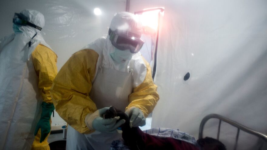 An Ebola patient is being checked by two medical workers on Wednesday in Beni, in the Democratic Republic of the Congo's North Kivu region.