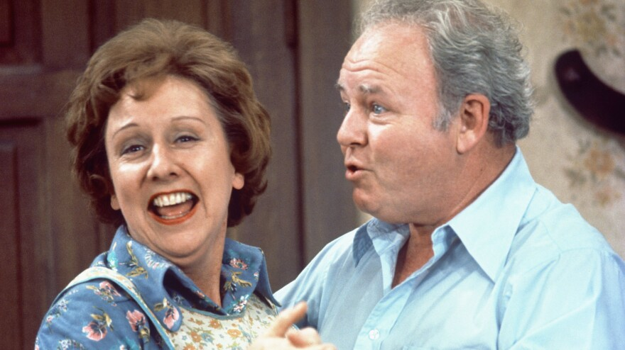 Jean Stapleton as Edith Bunker and Carroll O'Connor as Archie Bunker on the CBS TV series <em>All in the Family</em> in 1976. Stapleton died Friday at 90.