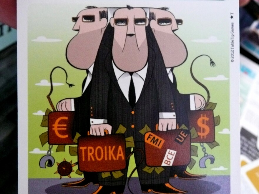 The dreaded troika card, decorated with a caricature representing the European Union, European Central Bank and International Monetary Fund. In Vem aí a Troika, the game ends when the troika card is played.
