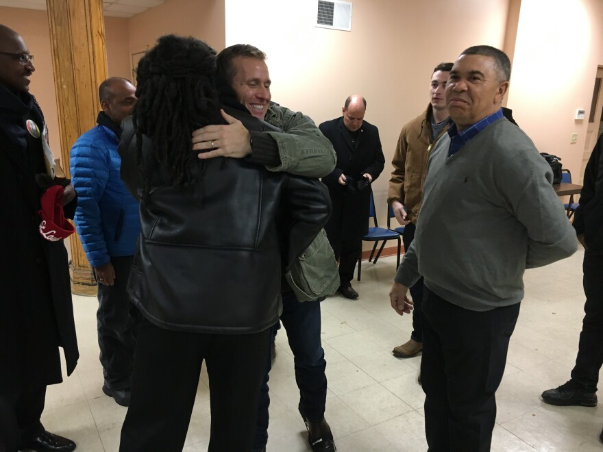 Missouri Gov.-elect Eric Greitens hugs Rev. Ken McKoy, a pastor with Progressive Zion A.M.E. Church. Greitens walked with McKoy as part of NightLIFE, a group that seeks to curb violence in north St. Louis neighborhoods.
