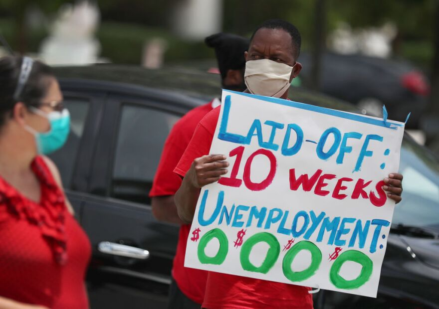 Joseph Louis joins others in a protest asking the state of Florida to fix its unemployment system on May 22, 2020 in Miami Beach, Florida. (Joe Raedle/Getty Images)