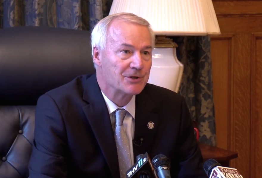 Gov. Asa Hutchinson speaking with reporters Tuesday about his support for the latest Republican healthcare proposal.