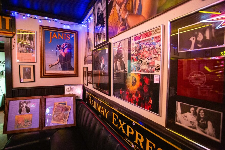 Music posters, including one of Janis Joplin, and signs hang on the wall of Threadgill's.