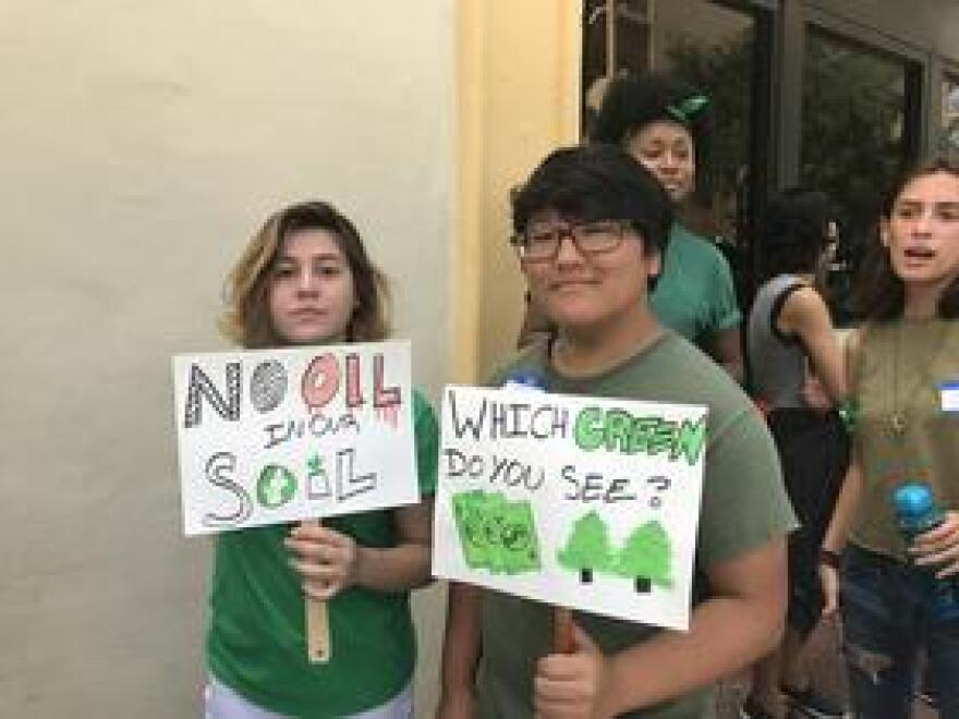"Two American Heritage students marched to city hall with signs on Saturday. ""No Oil In Our Soil"" and ""Which Green Do You See?"" propagated the group's message to politicians to think in a more environmentally conscious way."