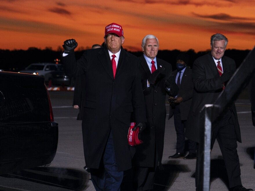 Mark Meadows, right, traveled with President Trump and Vice President Pence in the homestretch of the campaign, including to a rally in Traverse City, Mich. on Nov. 2.