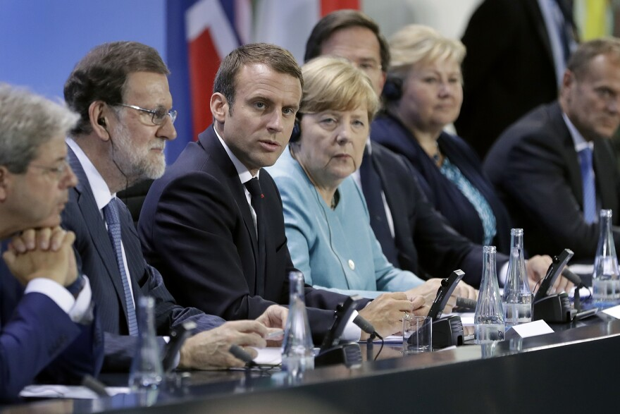 From left, Italian Prime Minister Paolo Gentiloni, Spain's Prime Minister Mariano Rajoy, France's President Emmanuel Macron, German Chancellor Angela Merkel, the Netherland's Prime Minister Mark Rutte, Norway's Prime Minister Erna Solberg and European Council President Donald Tusk, address the media during a joint press conference after a pre-G20 meeting at the chancellery in Berlin, Germany, Thursday, June 29, 2017. (Michael Sohn/AP)