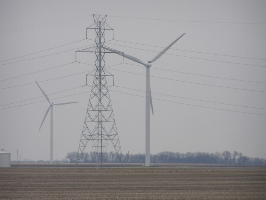Wind turbines and transmission towers in the Fowler Ridge Wind Farm in Benton County, Indiana.