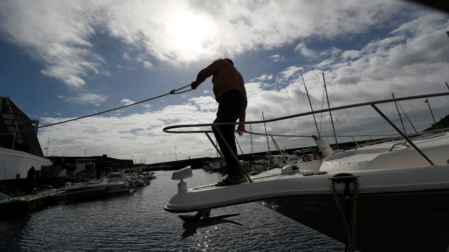 A man secures his boat before the arrival of Hurricane Lorenzo in Angra do Heroismo in the Azores islands, Portugal, on Tuesday.
