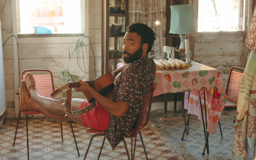 Donald Glover in a still from <em>Guava Island</em>, which he stars in with Rihanna. The film premiered at Coachella, where Glover's musical act Childish Gambino headlined on Friday.