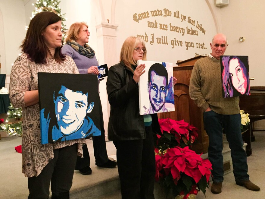 Amanda Jordan, Diane Yelle and Jim Zanfagna hold portraits of their children killed by overdoses at a service for families affected by addiction at the First Baptist Church of Plaistow on Dec. 20, in Plaistow, N.H. Anne Marie Zanfagna stands in the back.