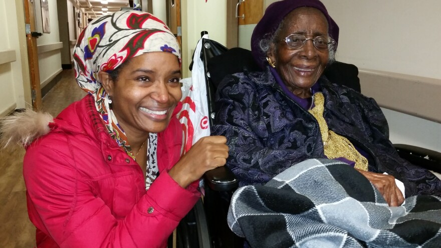 Keitra Bates (left) moved to tears upon meeting 106-year old Leila Williams at her nursing home. Bates recently discovered that Williams once ran Leila's Dinette in the building where Bates now runs Marddy's Shared Kitchen and Marketplace.