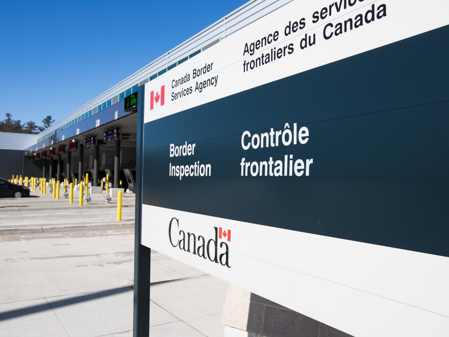 A vehicle enters a Canadian border station at the U.S./Canada border after the two countries closed their border for all non-essential travel in Lansdowne, Ontario, on March 22, 2020.