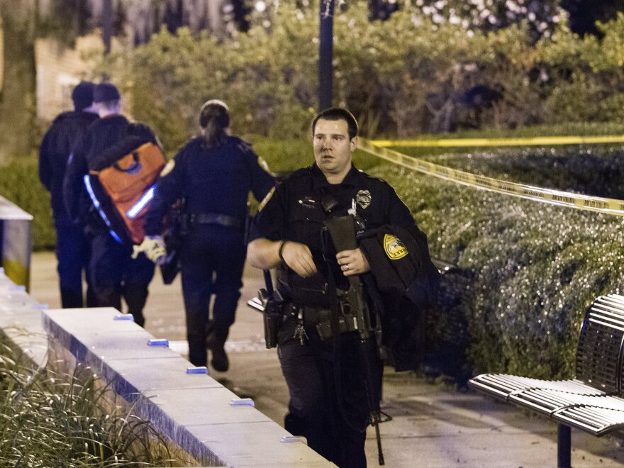 Tallahassee police investigate a shooting outside the Strozier Library on the Florida State University campus in Tallahassee, Fla., on Thursday. The gunman was shot and killed by police officers.