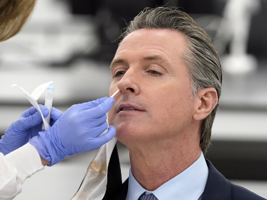 "California Gov. Gavin Newsom, pictured receiving a COVID-19 test on Oct. 30, apologized to residents on Monday for attending a birthday party with too many guests. ""I need to preach and practice, not just preach,"" he said."