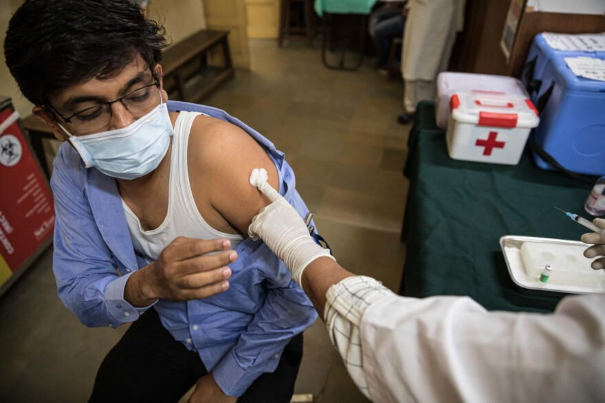 """""""I'm excited to call my wife. We'll celebrate with the family tonight,"""" says Amit Sonawane, 35, an engineer at the district health office, after getting his first vaccine dose."""