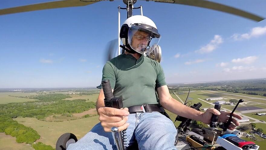 Doug Hughes flies his gyrocopter March 17 near the Wauchula Municipal Airport in Wauchula, Fla.