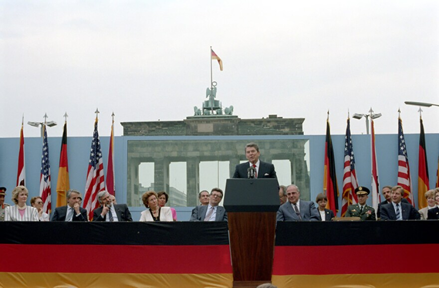 "President Ronald Reagan delivers his famous ""tear down this wall"" speech in June 1987 at the Brandenburg Gate. 