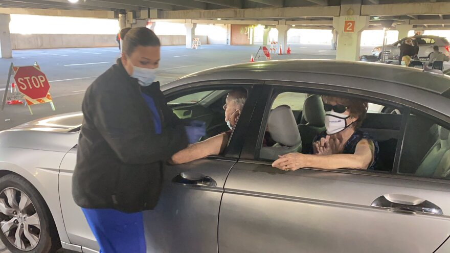 Drive-through coronavirus vaccines are administered at University Mall in Tampa on Jan. 21, 2021.