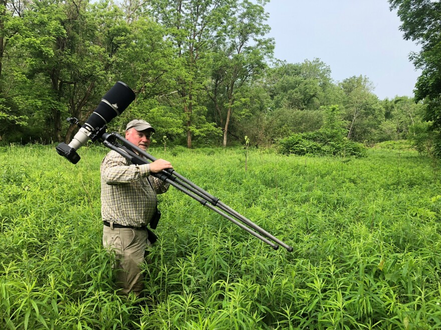 Photographer Jim Roetzel hikes his camera gear to a remote spot along the Cuyahoga.