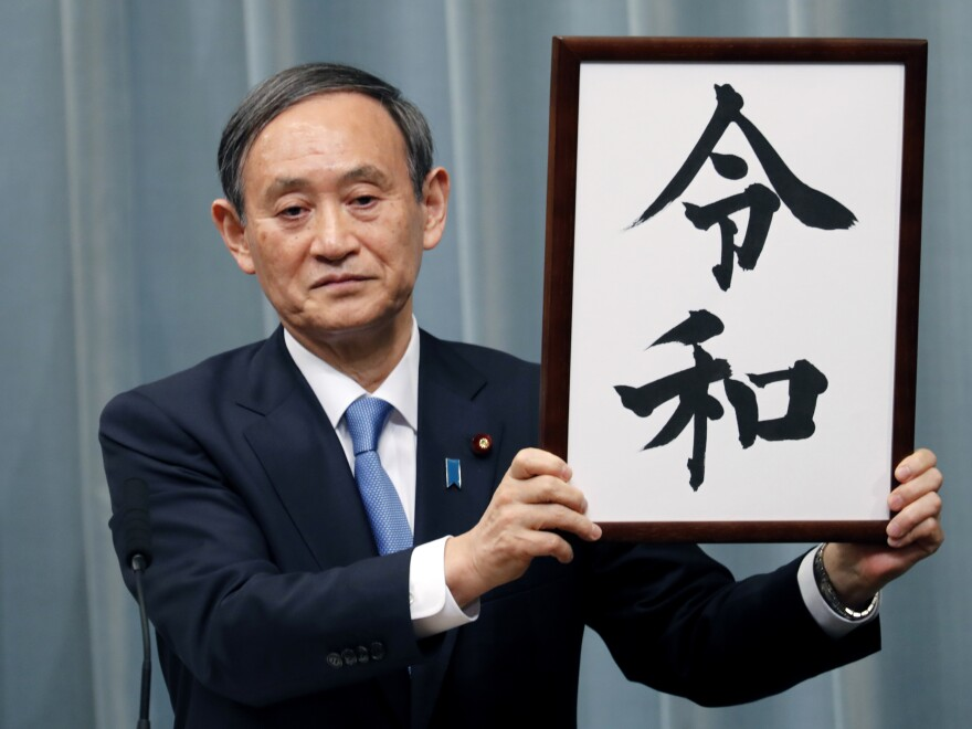 "Japan's Chief Cabinet Secretary Yoshihide Suga unveils the name of new era ""Reiwa"" on Monday. The new era starts May 1, when Crown Prince Naruhito takes the throne from his father."