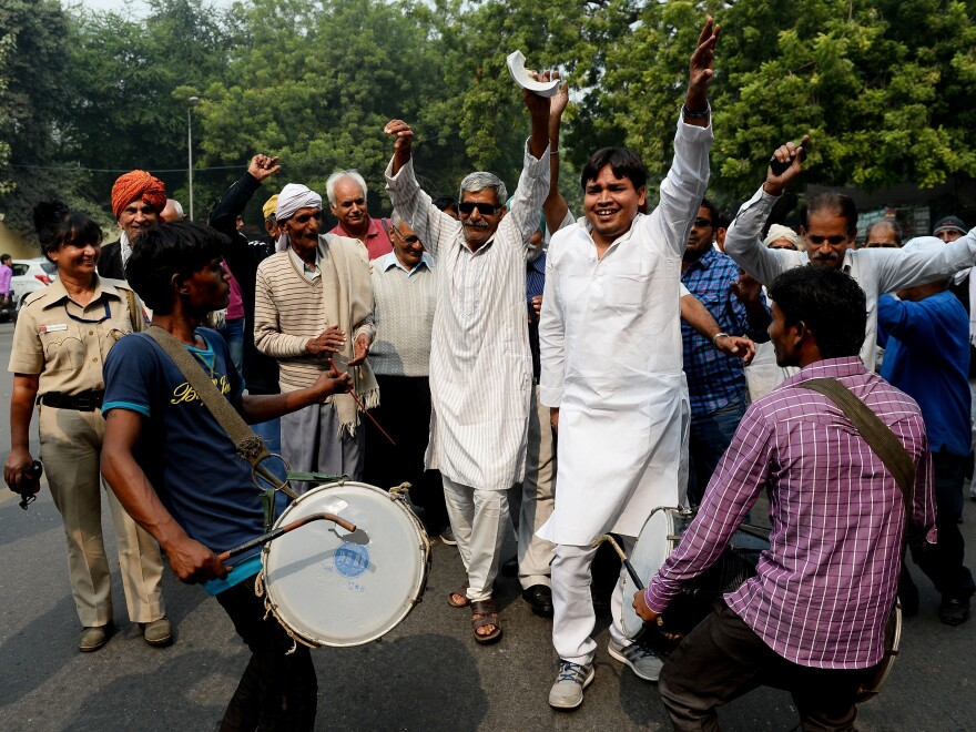 In New Delhi, on Nov. 8, Indian Janta Dal United activists and supporters celebrate a victory by the alliance led by their party in the Bihar state assembly elections.